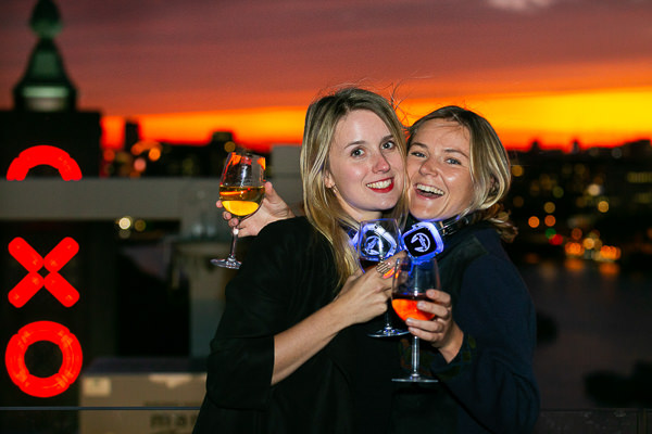 women hugging at felt music party sea containers london