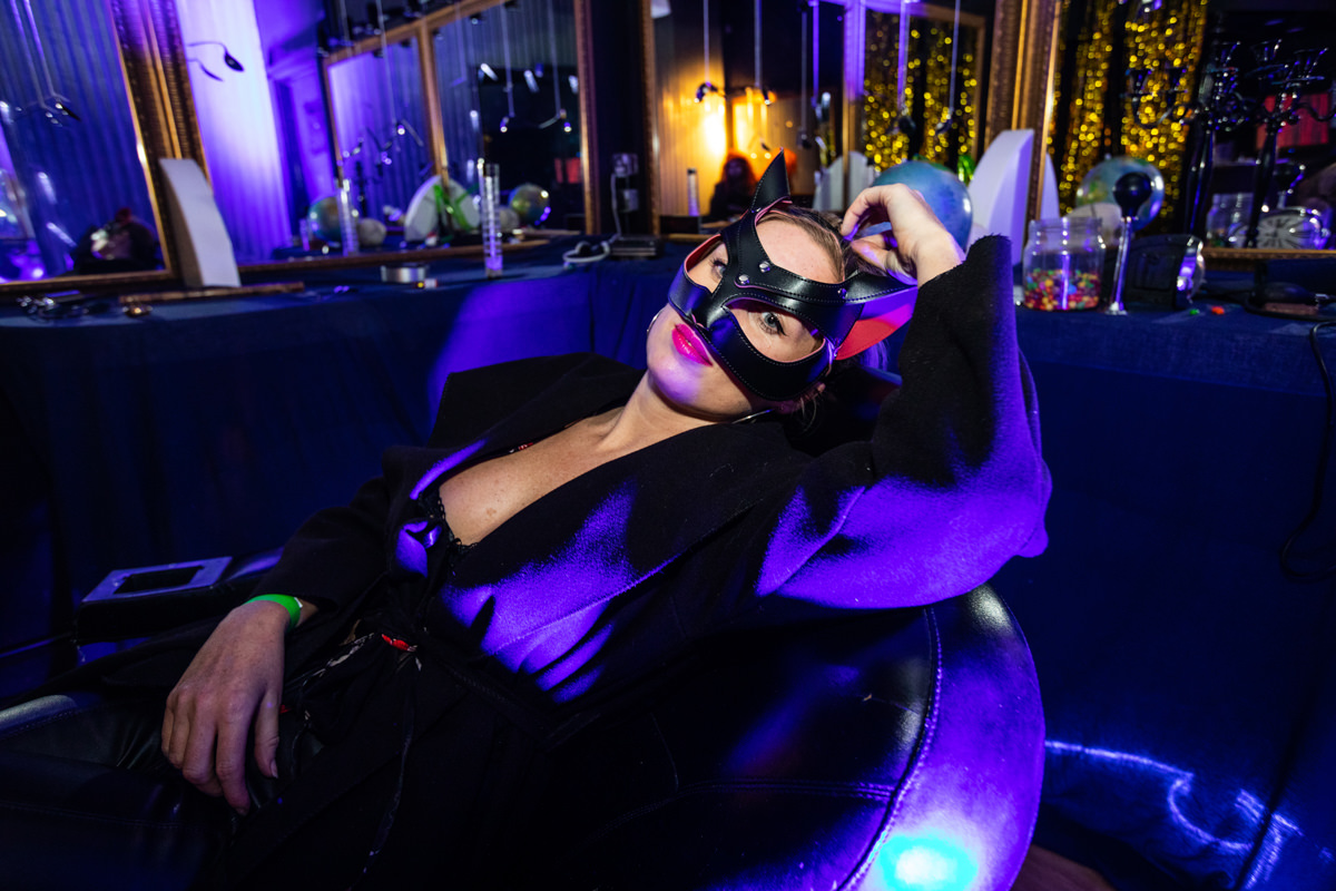 woman in leather mask reclining in chair