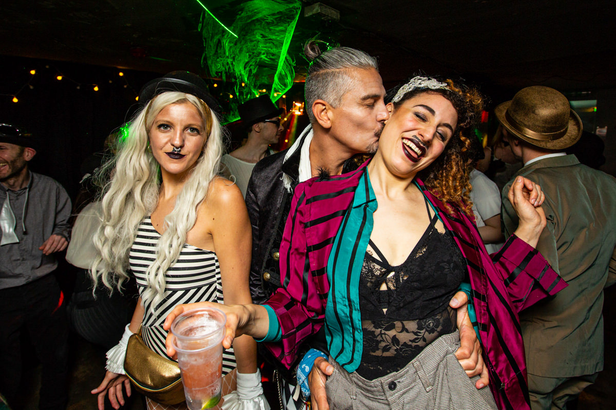 man kissing womans neck on dancefloor