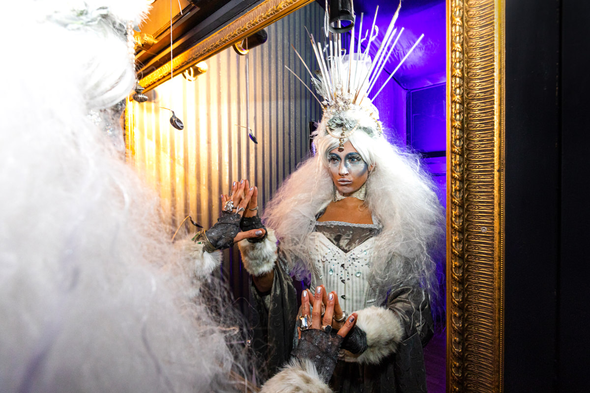 ice queen at immersive party london looking in the mirror