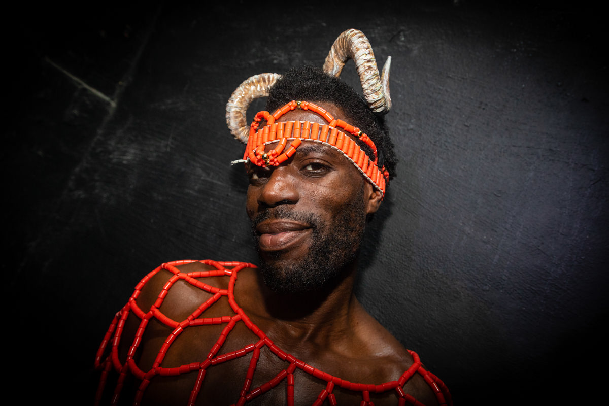 man with got horns at party