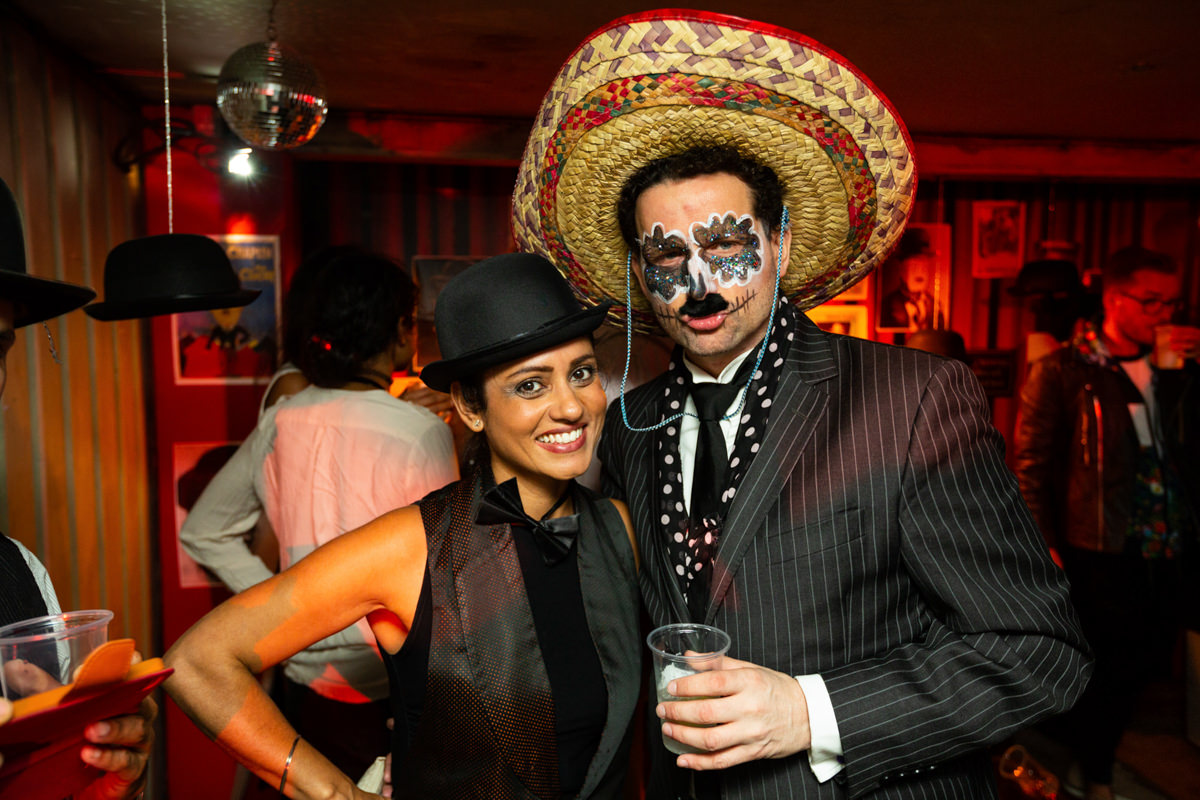 man and woman in fancy dress at malice arts party