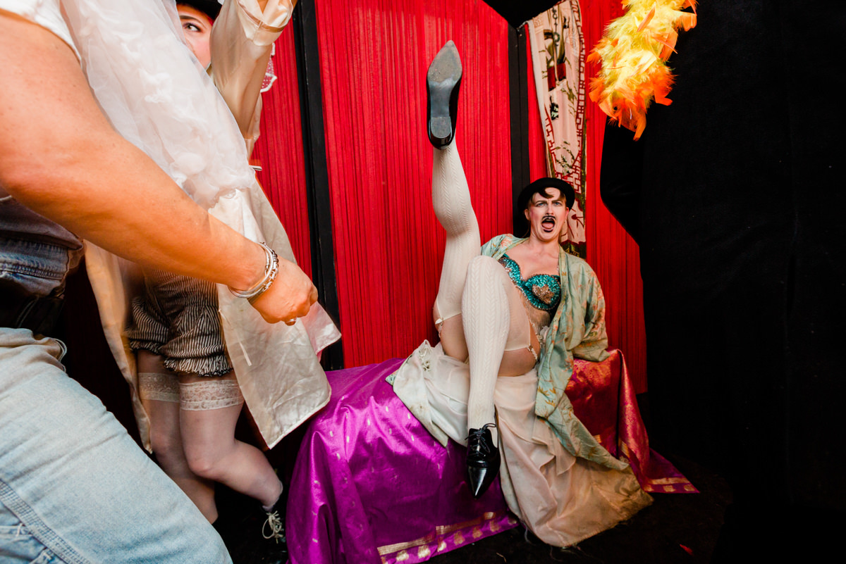 man in drag with legs up at party