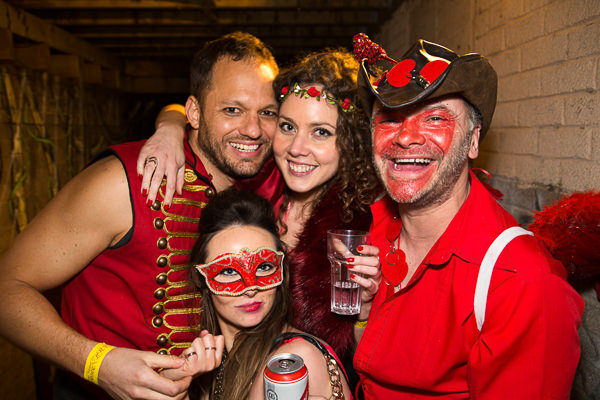 people dressed in red enjoying themselves at party