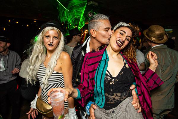 man kissing womans next in party london bridge