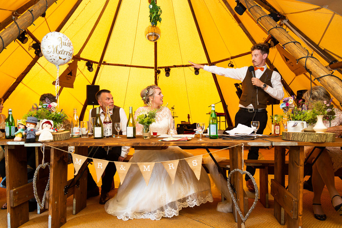 groom in yellow tipi wedding clavering