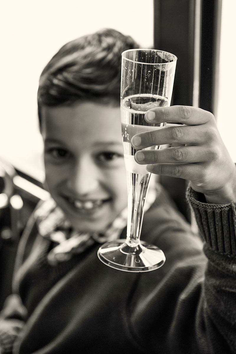 boy with champagne on bus london