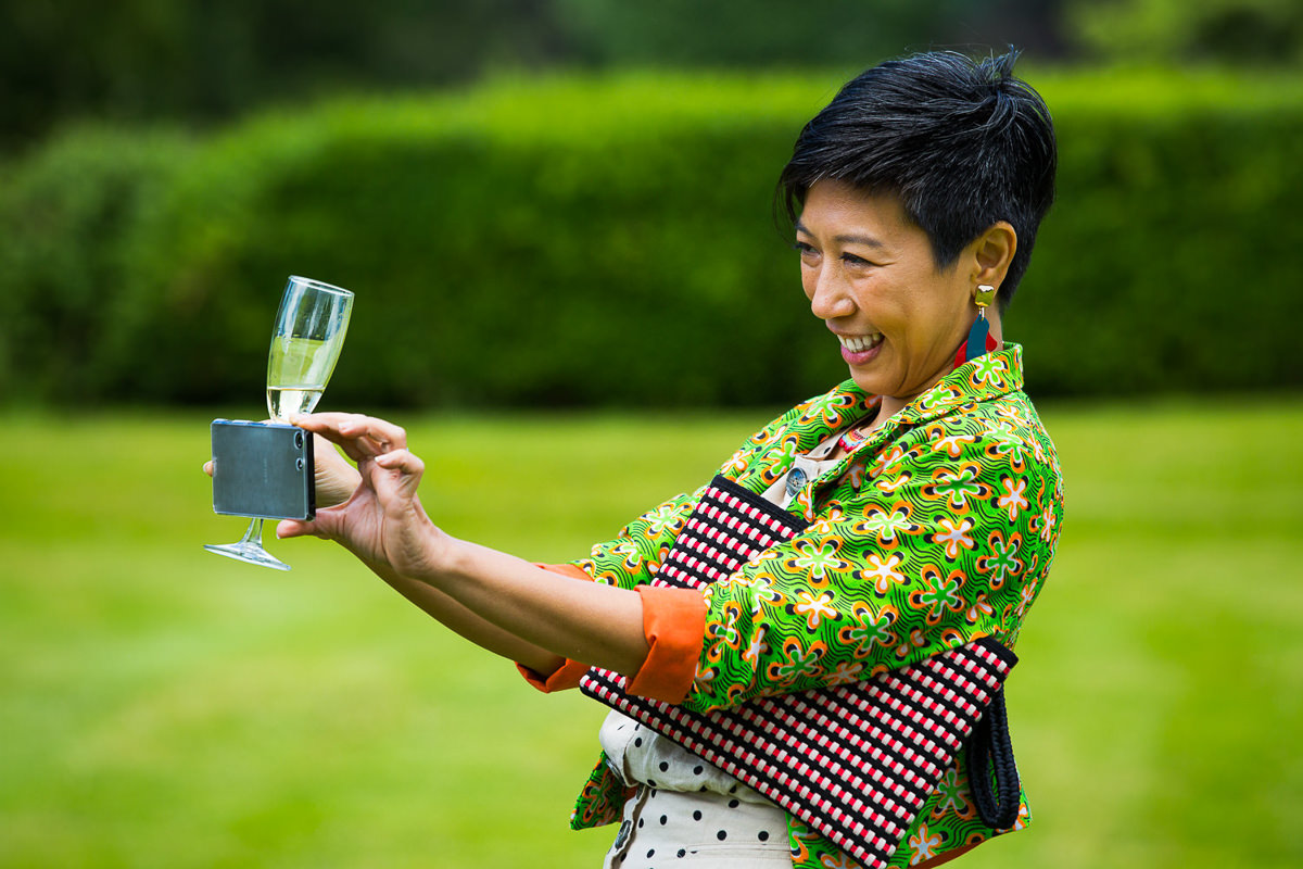 wedding guest with phone