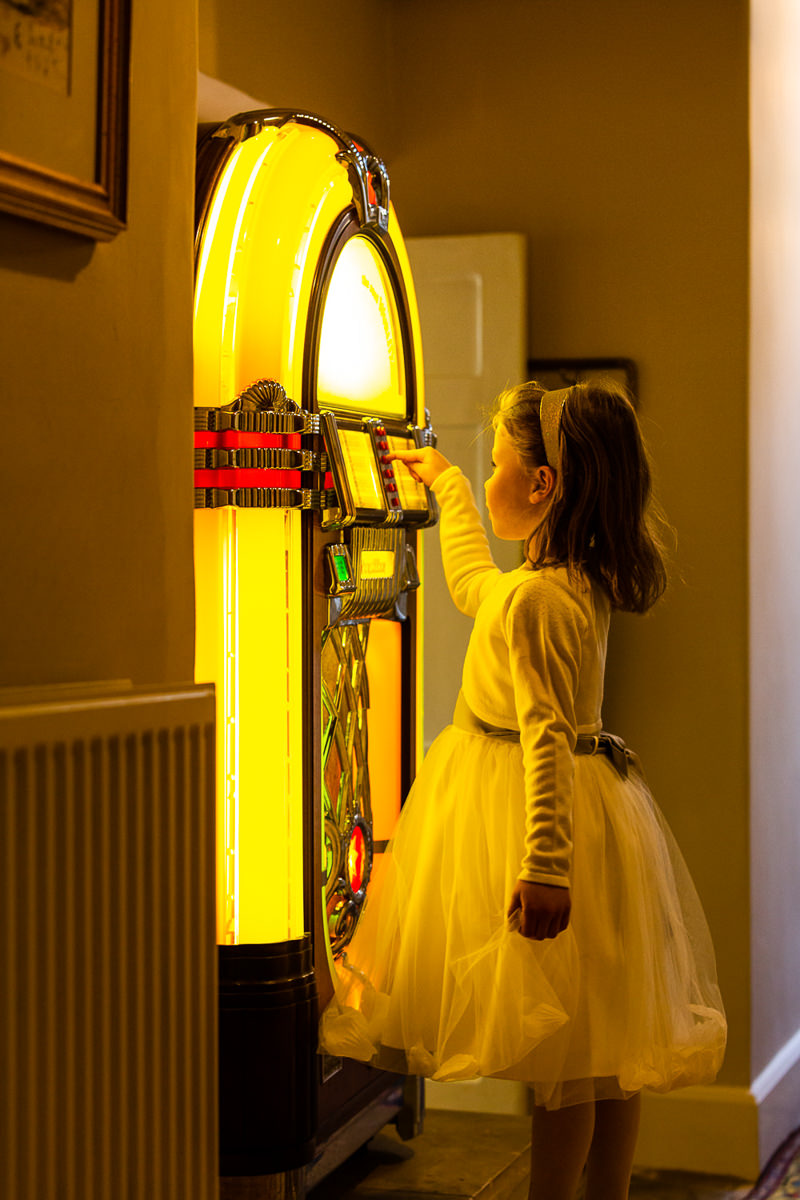 girl with jukebox at wedding