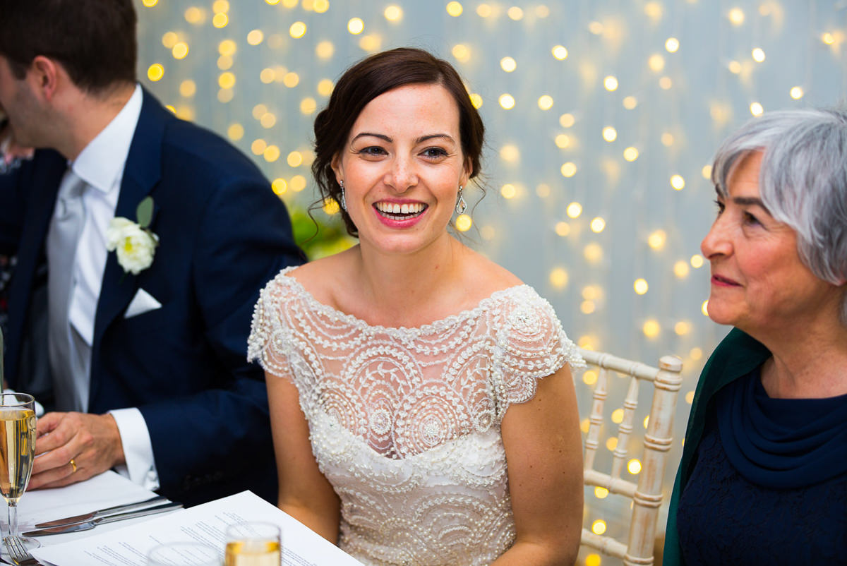 bride with fairy lights