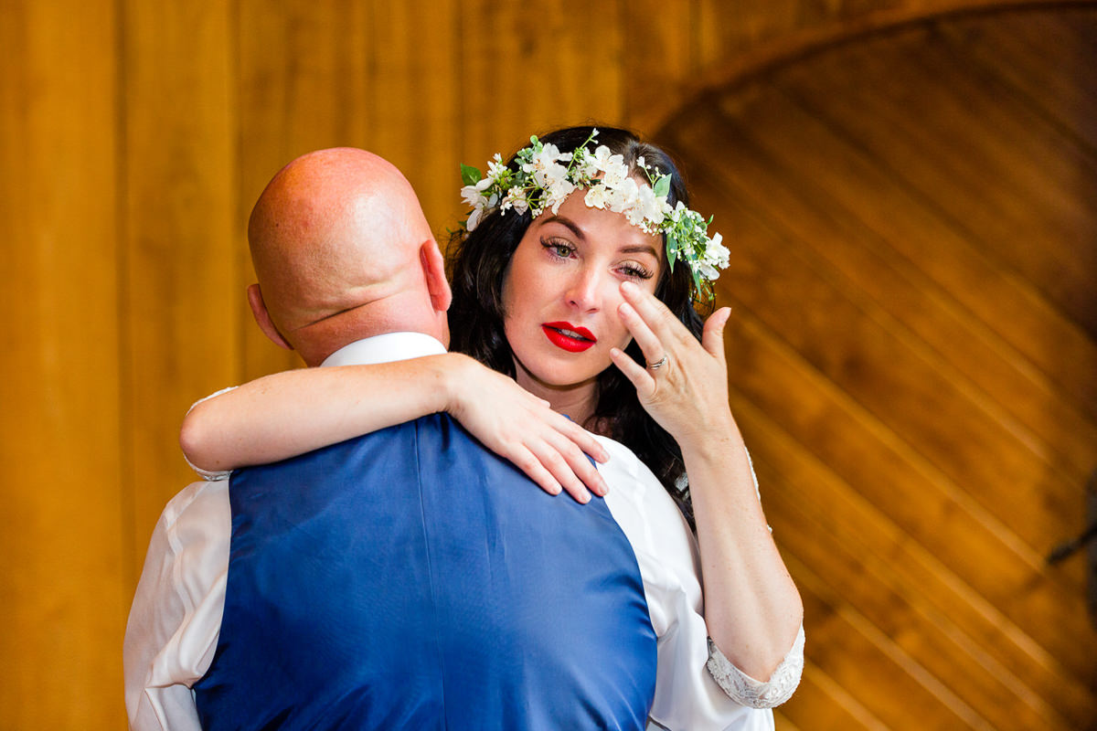 woman dancing with dad and crying wedding