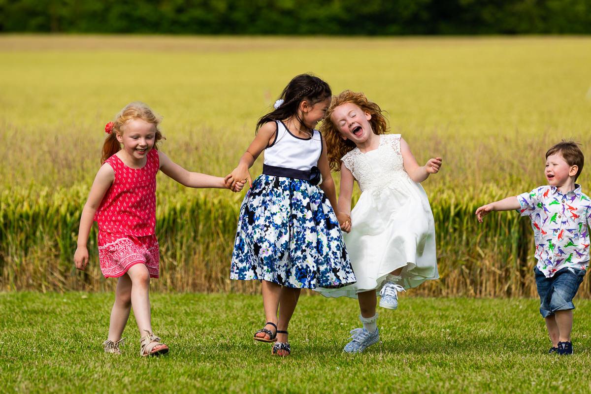 children in wheat fields clavering essex england