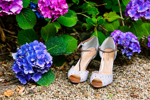wedding shoes next to flowers