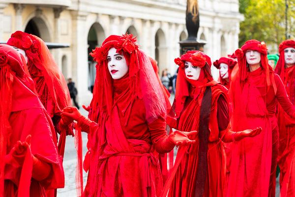 women in red at demonstration extinction rebellion