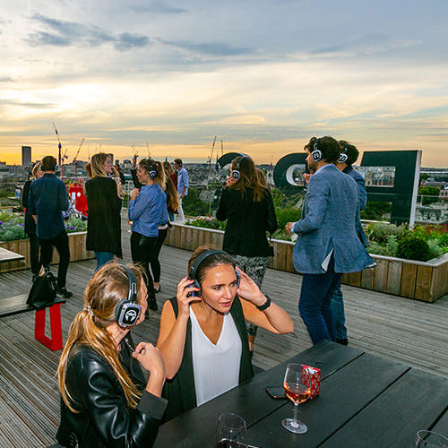people having party on the sea container building roof london